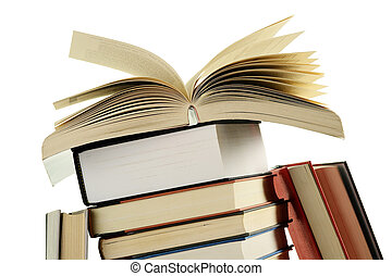 Composition with stack of books on white background