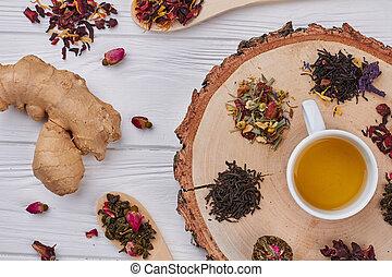 Composition with tea on a wooden background.