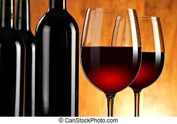Composition with two wineglasses and bottles of red wine