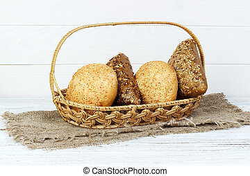 Composition with variety of buns baking products on wooden table