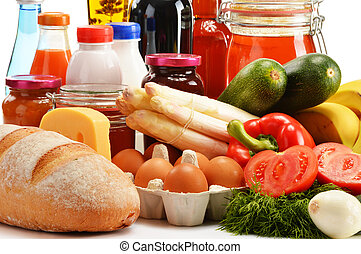 Composition with variety of grocery products on white
