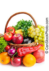 Composition with vegetables and fruits in wicker basket isolated on white. Vertical photo.