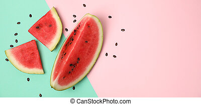 Composition with watermelon slices on two tone background, top view