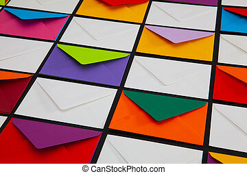Composition with white and colored envelopes on the table.
