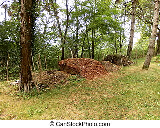 Compost Heaps - Compost heaps in a country garden