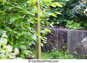 compost pile in garden