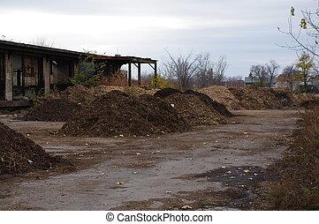 Numerous compost piles