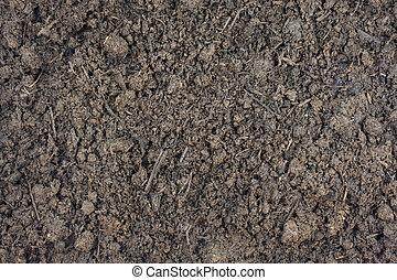 composted steer manure background - moist steer manure...