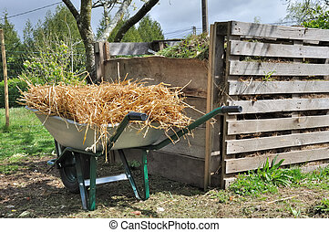 composter and wheelbarrow