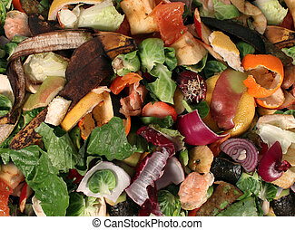 Composting pile of rotting kitchen fruits and vegetable...