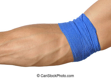 Compression wrap - Closeup of arm wrapped at elbow with blue...