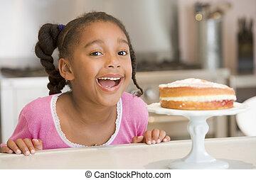 compteur, jeune regarder, gâteau, fille souriant, cuisine