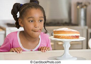 compteur, jeune regarder, gâteau, girl, cuisine