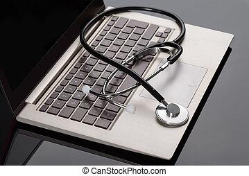 computador portatil, encima, estetoscopio, médico