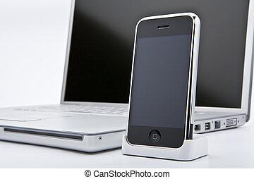 computadora de computadora portátil, con, teléfono celular