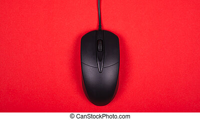 computer black mouse on red background top view