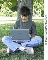 computer boy #2 - teen boy working on a laptop