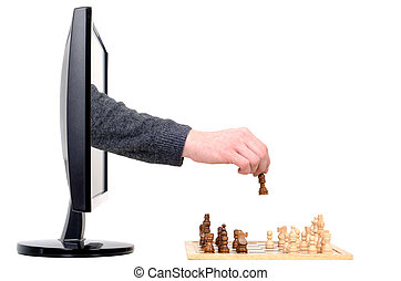 computer chess - a hand coming from a computer plays chess