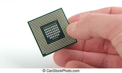 Computer CPU closeup - Processor held in human hand