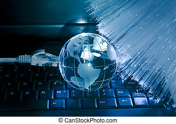 computer data concept with earth globe against fiber optic ...