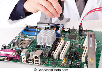 Computer engineer working on a old motherboard