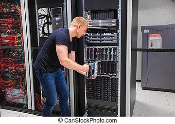 Computer Engineer Installing Server Into Blade Enclosure -...
