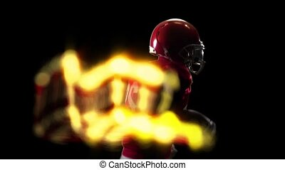 Computer graphics, american football player running with ball and fire