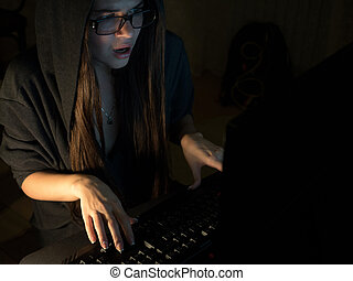 Computer hacker girl stealing information with laptop
