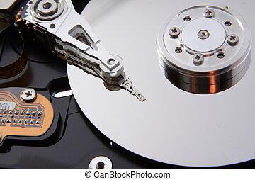 Computer hard disc  - A close up of a computer hard disc