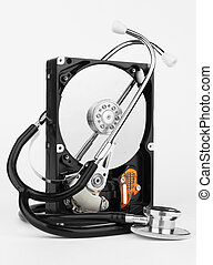Computer hard drive and a stethoscope