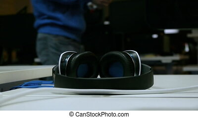 Computer headphones lie on the table