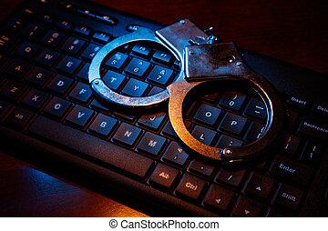 computer keyboard and handcuffs - computer keyboard and...