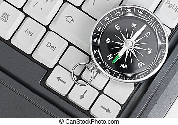 Computer keyboard and retro compass, business decision