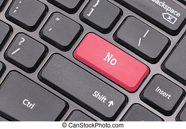 """Computer keyboard closeup with """"No"""" text on red  enter key"""
