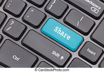 """Computer keyboard closeup with """"Share"""" text on blue enter key"""