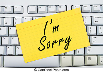 I'm Sorry - Computer keyboard keys with index card with ...