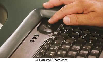 Computer keyboard. Male hand presses the computer keyboard
