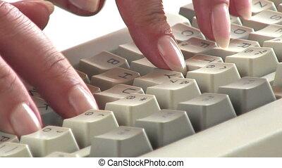 Computer keyboard - Typing on a white keyboard
