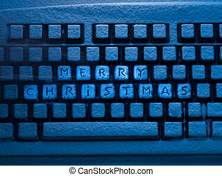 computer keyboard with lettering merry christmas on buttons...