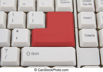 Computer keyboard with red Enter key, business concept