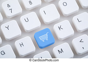 Computer keyboard with shopping cart button. Online shopping concept.