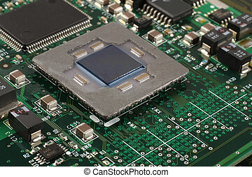 Computer microprocessor on integrated circuit motherboard closeup