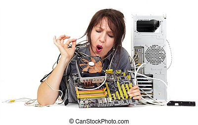 woman trying to find solution on computer motherboard