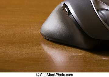 Computer mouse on a wooden desk