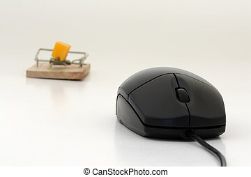 Computer mouse - A computer mouse and a mousetrap with...