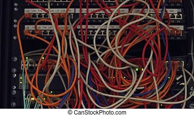 Computer network equipment and multiple plugs and cables. 4K...