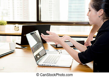 Computer notebook in office with woman for work.