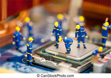 Computer repair concept - Miniature technician repairing ...