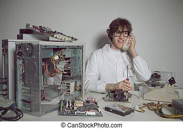 Computer Repair - Happy computer technician in his...