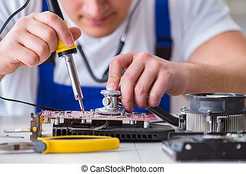 Computer repairman repairing desktop computer